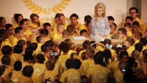 Gwen  speaking with children
